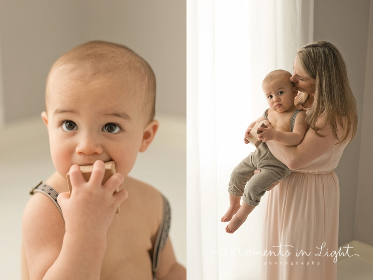 One year-old boy playing with blocks with mother by baby photographer in The Woodlands