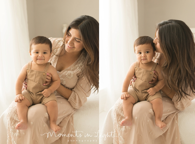 baby boy and mom in neutral tones on bed in Houston photo studio