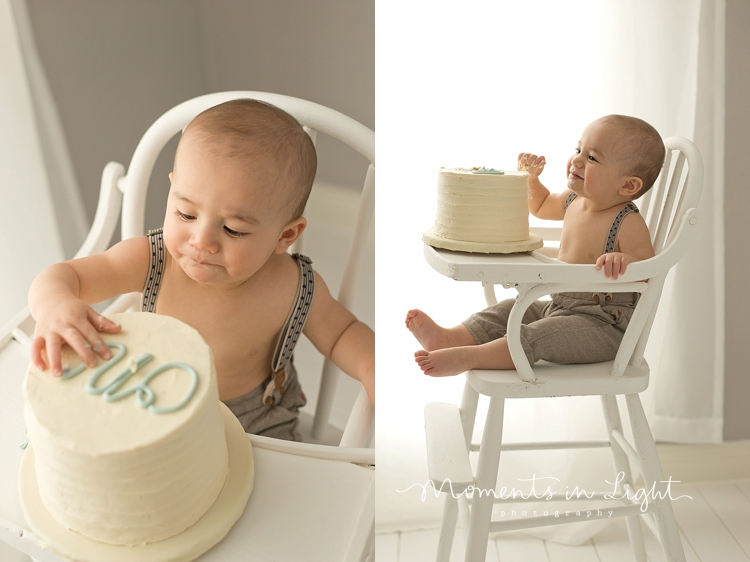 Baby boy eating first birthday cake in window of Montgomery, Texas photography studio
