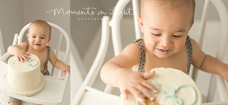One year-old baby boy eating birthday cake by Houston baby photographer
