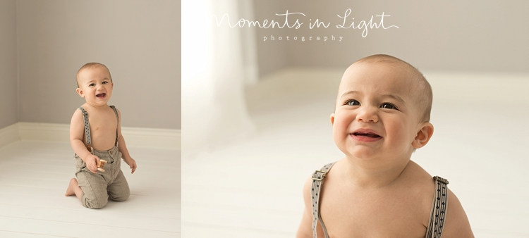 One year-old boy laughing in baby photography studio in The Woodlands