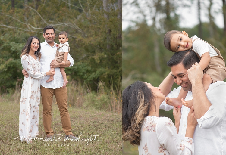 Baby boy on father's shoulders in a field by family photographer in Montgomery, Texas