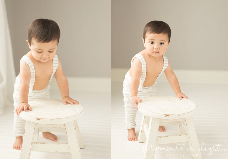baby boy in white overalls with stool in Houston photo studio