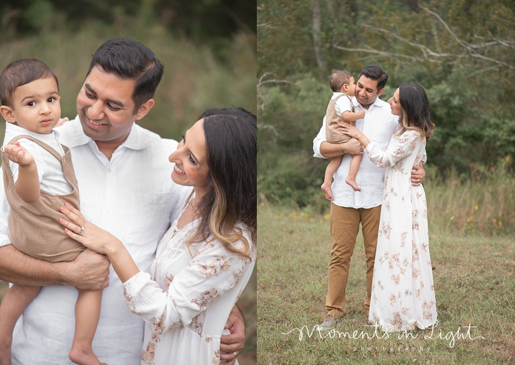 Baby boy kissing father's cheek in a field by family photographer in The Woodlands