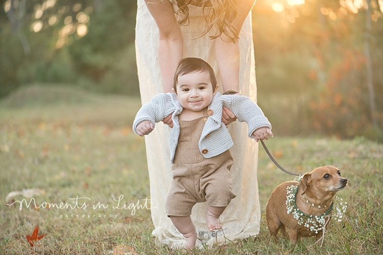 Baby boy in a field with his mother and their dog by Houston family photographer