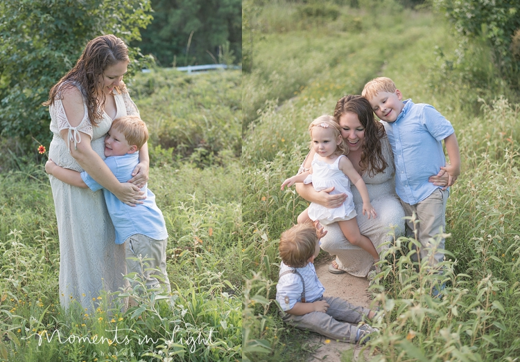 mom in lace dress with young children in field in Montgomery, Texas