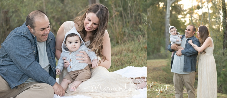 Mother and father holding baby boy in a field in The Woodlands