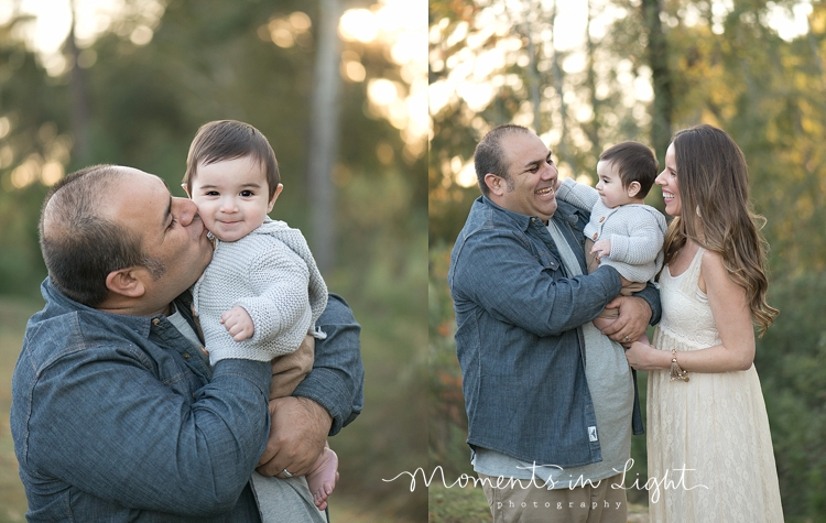 Mother and father holding baby son in a Houston field by Montgomery, Texas family photographer