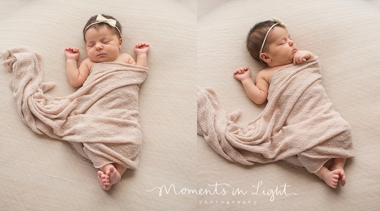 Baby wrapped in a blanket sleeping on a bed by Houston newborn photographer