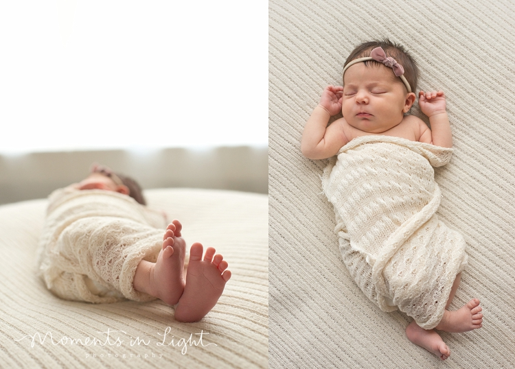 Sleeping baby girl swaddled in a white wrap in a Houston newborn photography studio