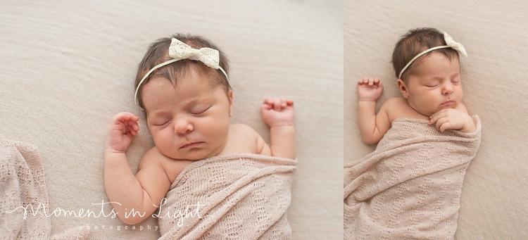 Baby girl wearing headband sleeping in a newborn photography studio in Montgomery, Texas